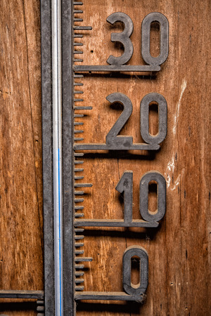 humidity gauge: Vintage thermometer celsius 20 degrees blue level detail close up mercury