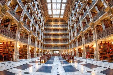 BALTIMORE, USA - JUNE 23, 2016 Bookshelf inside Peabody Library a research library for John Hopkins University Editoriali