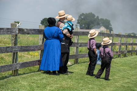 amish buggy: LANCASTER, USA - JUNE 25 2016 - Amish people in Pennsylvania. Amish are known for simple living with touch of nature contacy, plain dress, and reluctance to adopt conveniences of modern technology