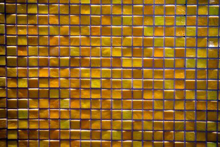 decorate: orange and yellow mosaic vitrified tile background texture Stock Photo