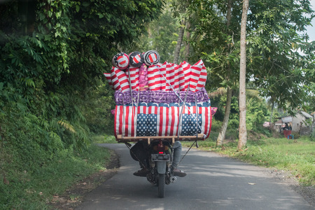 motorbike usa flag matrass seller in bali indonesia on the road Stock Photo