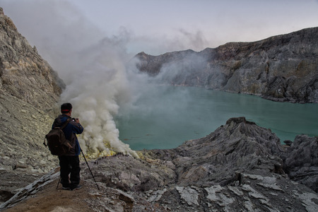 kilos: JAVA, INDONESIA - AUGUST, 9, 2016 - Miners are carrying sulfur from Ijen Volcano Blue flames at night, more than 100 kilos each one for a cheap salary