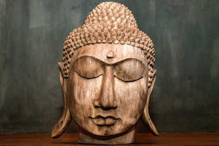 gautama buddha: gautama buddha head closed eyes wooden sculpture statue detail