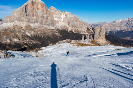 Skier in dolomites snow panorama landscape