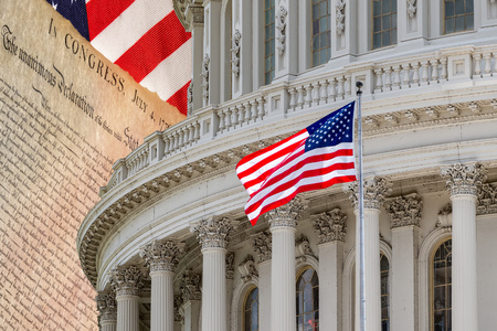 Washington DC capitol on American Declaration of independence 4th july 1776 on usa flag background Stock Photo