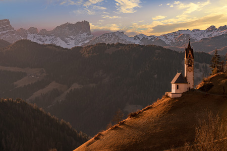 dolomites mountain church at sunset view landscape panorama