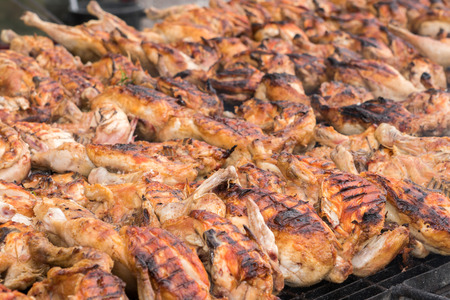 Many roasted chickens grilled at barbecue detail
