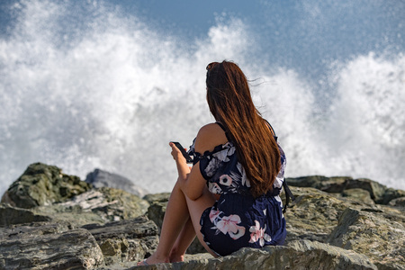 people taking pictures of Sea Storm and tempest on the coast