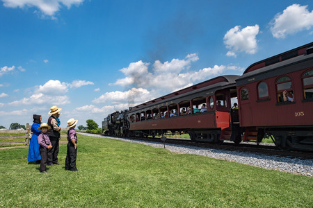 conveniences: LANCASTER, USA - JUNE 25 2016 - Amish people in Pennsylvania. Amish are known for simple living with touch of nature contacy, plain dress, and reluctance to adopt conveniences of modern technology