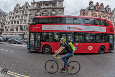 regent: LONDON, ENGLAND - JULY 16 2017 - Tourists and locals in Piccadilly Circus congested town traffic of UK Capital
