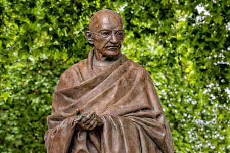 LONDON, ENGLAND - JULY 15 2017  - ghandi statue in london town one of most visited in city attractions
