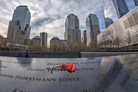 NEW YORK, USA - APRIL 23 2017 - people visiting ground zero  fountain and 911memorial Editorial