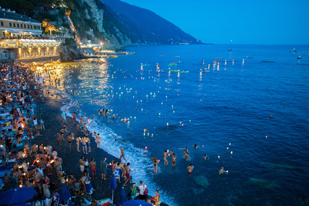 CAMOGLI, ITALY - AUGUST 6 2017 -  The traditional celebration that Camogli inhabitants dedicate to the Holy Virgin, worshipped with the title of Star of the Sea. During the night when thousands of tiny lit candles are left bobbing on the water from the  Editorial