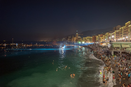 thousands: CAMOGLI, ITALY - AUGUST 6 2017 -  The traditional celebration that Camogli inhabitants dedicate to the Holy Virgin, worshipped with the title of Star of the Sea. During the night when thousands of tiny lit candles are left bobbing on the water from the  Editorial