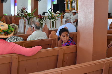 local 27: AITUTAKI, COOK ISLAND - AUGUST, 27 2017 - Local people at the christian mass wearing traditional colorful polynesian dress