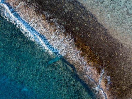 waves on reef of rarotonga polynesia Cook islands aerial landscape
