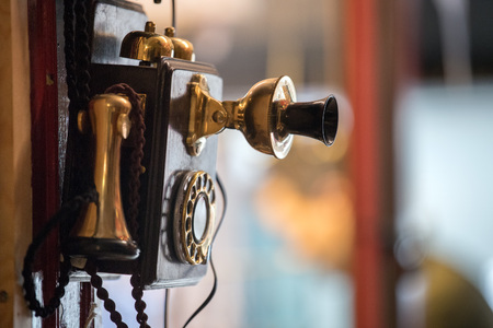 old antique wall telephone close up