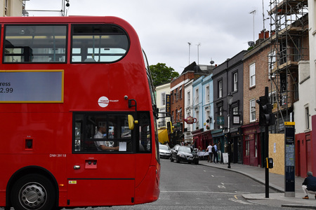 portobello: LONDON, ENGLAND - JULY 15 2017 - portobello road london street colorful marketplace one of the most visited attractions of united kingdom capital town