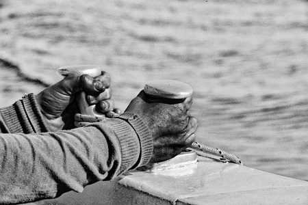 hands of black Migrant refugee detail on boat Stock Photo