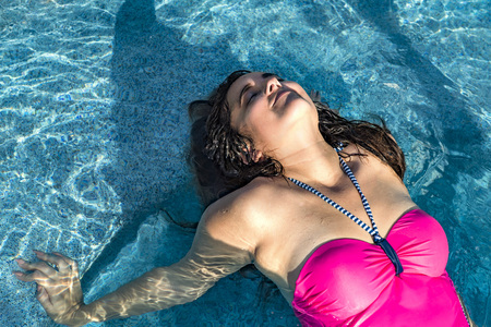 beautiful black hair lady latina mexican woman on a Jacuzzi pool  background  Stock Photo