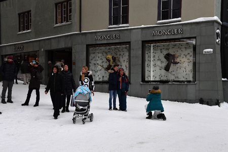 ST MORITZ, SWITZERLAND - DECEMBER 30 2017 - Luxury swiss mountain alps town crowded of tourists for new years eve