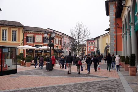 SERRAVALLE SCRIVIA, ITALY - JANUARY 15 2018 - Lot of people buying fashion items at the beginning of designer outlet winter Sale season