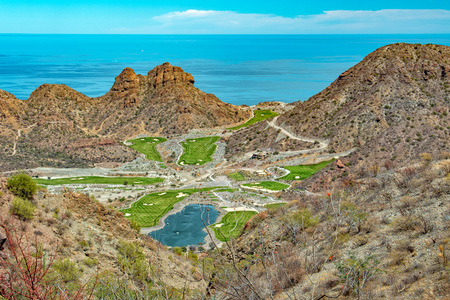 desert golf course green by the California sea