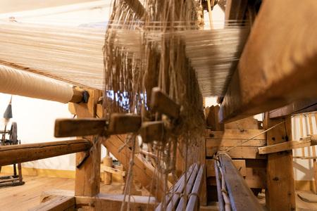 vintage old loom sewing weaving machine close up 写真素材