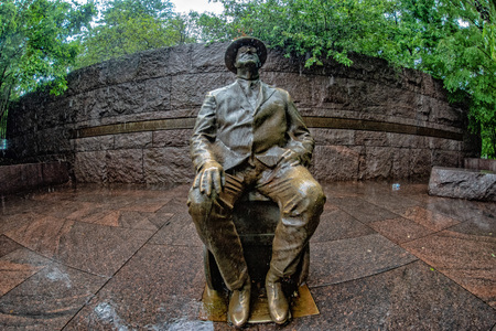 WASHINGTON DC, USA - MAY 17 2018 - Roosevelt memorial statue under the rain in Washington DC