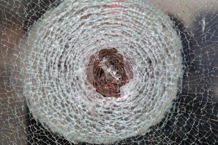 broken bulletproof glass close up detail
