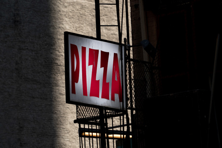red on white Pizza sign in New York Usa Stock Photo