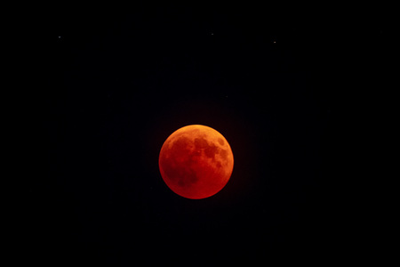 red moon eclipse on black