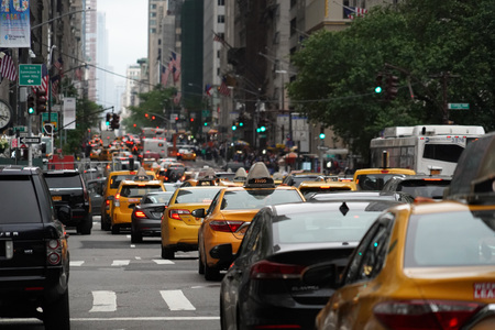 NEW YORK, USA - MAY 25 2018 - Yellow cabs and cars stucked in traffic in the Midtown Manhattan jam
