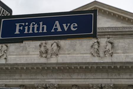 fifth avenue sign new york city with library way street