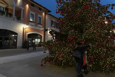 SERRAVALLE SCRIVIA, ITALY - DECEMBER 2 2018 - People buying and shopping fashion items in mid summer designer outlet christmas season Editorial