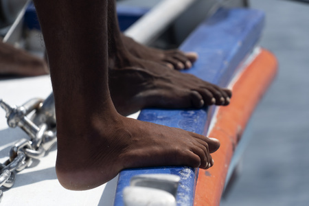 black man migrant feet detail close up no shoe