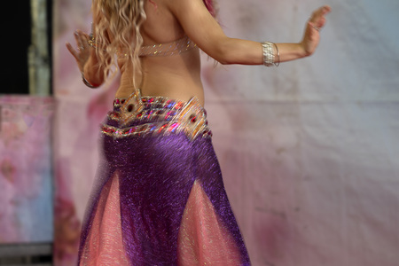 Oriental belly dancer beutiful move detail