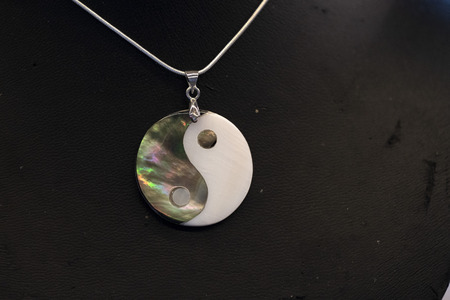 Yin Yang symbol pendant isolated detail