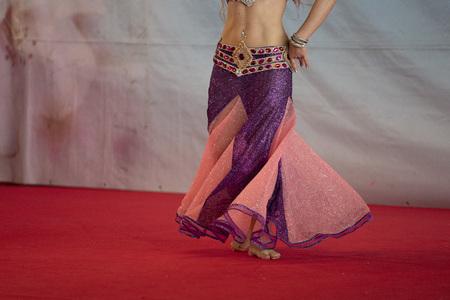 Oriental belly dancer beutiful move detail