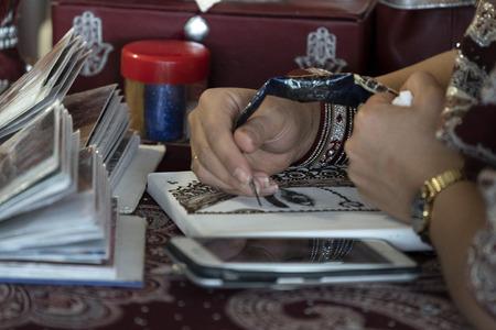 Hanna tatoo while drawing close up Stock fotó