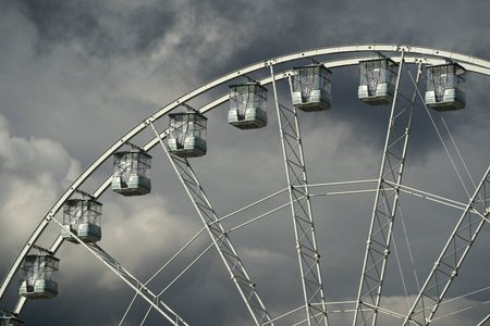 panoramic ferris big wheel detail on cloudy sky background