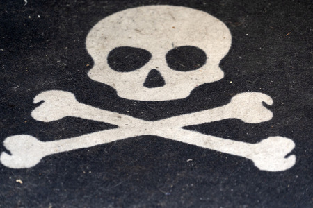 Jolly roger pirate symbol isolated