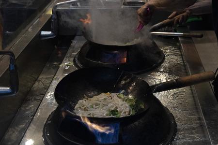 wok rice spaghetti while cooking