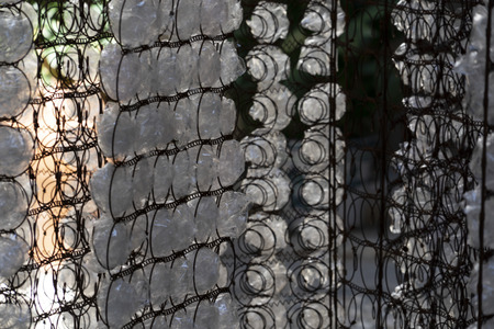 many plastic bottle on metal rusted grid Stock Photo