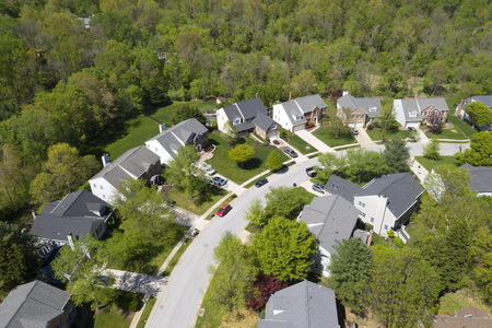 upper middle class american neighborhood with curving street in the east coast