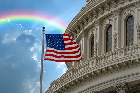 Washington DC Capitol with waving flag on rainbow after rain day