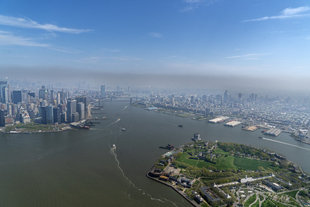 governor island and new york city manhattan aerial view from helicopter