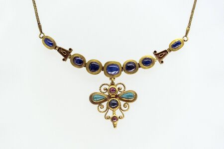 Etruscan style gold necklage detail isolated on white 스톡 콘텐츠