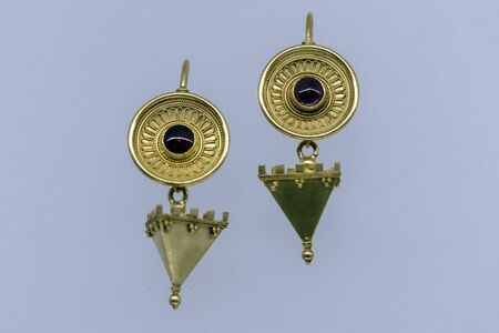 Etruscan style gold erarrings pendant detail isolated on white