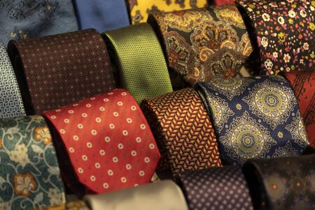 different colors silk tie on display stand
